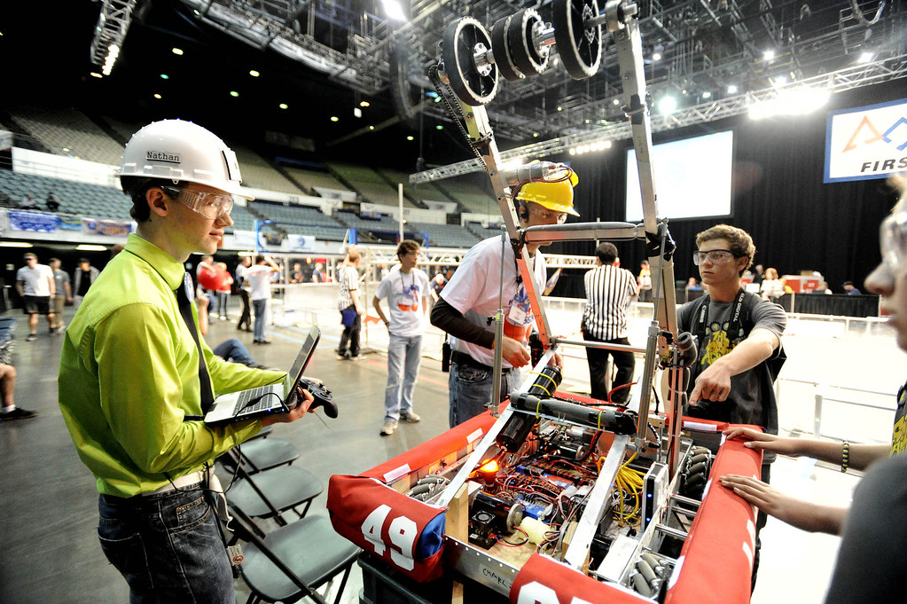. Nathan Pannell from Long Beach Poly prepares the team\'s robot, named Charlie, for test drive at the First Robotics Competition, a Raytheon sponsored event where local high school students  built robots to compete, kicked off today at the Long Beach Arena in Long Beach, CA. on Wednesday March 19, 2014. (Photo by Sean Hiller/ Daily Breeze).