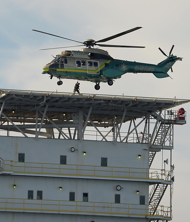 . Los Angeles County Sheriff�s helicopter, Rescue 5, flies over the scene at a homeland security training drill at oil platform Eureka, off the coast between Catalina and Long Beach on Tuesday, November 26, 2013. (Photo by Sean Hiller/ Daily Breeze).