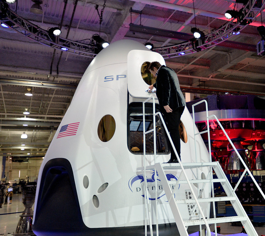 . Elon Musk, SpaceX CEO and founder, climbs into the latest Dragon V2 spacecraft,  in Hawthorne, CA. on Thursday May 29, 2014. (Photo by Sean Hiller/ Daily Breeze).