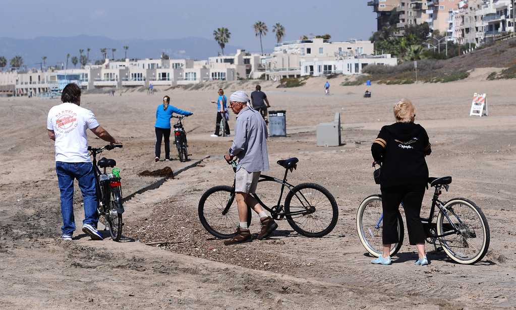 . In Playa Del Rey, the bikepath was covered in a few inches of sand and debris on Monday after weekend high surf washed up, causing minor problems for cyclists. This specific spot was about 200 feet long, but there were other areas as well near Dockweiler State Beach. Photo by Brad Graverson/The Daily Breeze/3-3-14
