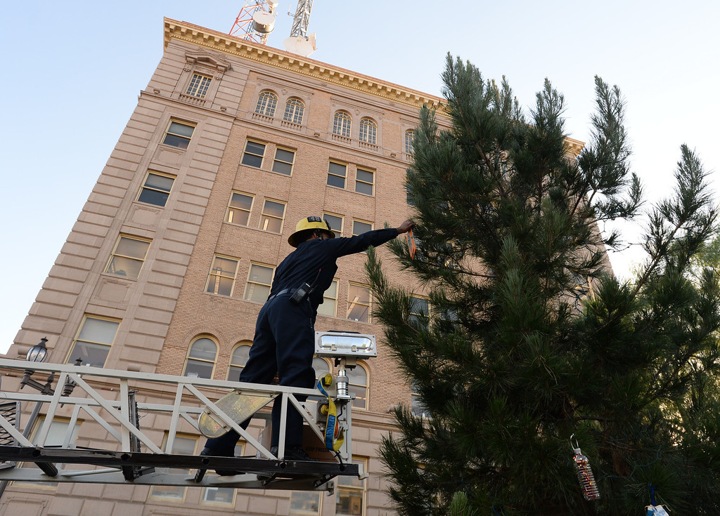 . A 25 year old time capsule was uncovered during the annual tree lighting at Pepper Tree Plaza Thursday, December 05, 2013, in San Pedro, CA. LA City Station 48 firefighter Hani Jejjoni uses a truck\'s ladder to decorate the tree in the plaza. Photo by Steve McCrank/DailyBreeze