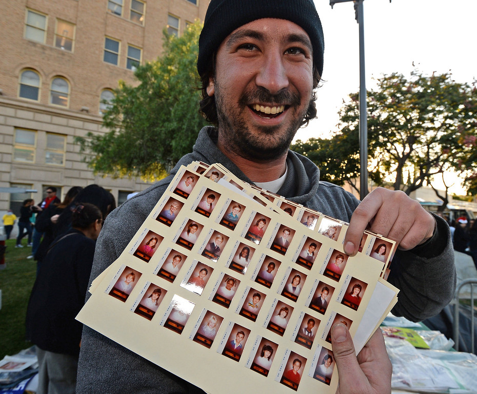 . A 25 year old time capsule was uncovered during the annual tree lighting at Pepper Tree Plaza Thursday, December 05, 2013, in San Pedro, CA.  Sam Uglesic laughs as he finds his photo among class pictures from Taper Elementary School that was in the capsule.  Photo by Steve McCrank/DailyBreeze