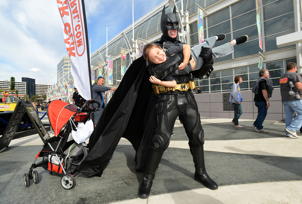 . Dressed as Batman, Jason Baker holds up his son Alexander at the 5th annual Long Beach Comic Con & Horror Con, held at the Long Beach Convention Center.   Long Beach Calif., Saturday, November, 23, 2013.   (Photo by Stephen Carr / Daily Breeze)