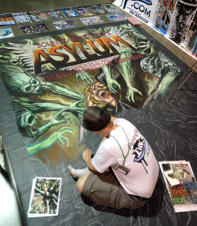 . Artist Eric Maruscan works on a chalk drawing during the 5th annual Long Beach Comic Con & Horror Con, held at the Long Beach Convention Center.   Long Beach Calif., Saturday, November, 23, 2013.   (Photo by Stephen Carr / Daily Breeze)