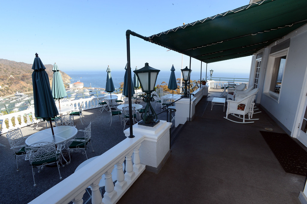 . Avalon, Calif., -- 09-04-13-  A terrace overlooks Avalon at The Inn On Mt. Ada, once the home of William Wrigley, Jr., who bought 99% of Catalina Island in 1919. The building was completed in 1921 sit 350 feet above the city of Avalon and is now an Inn. This year Avalon turns 100.    Stephen Carr/  Press-Telegram