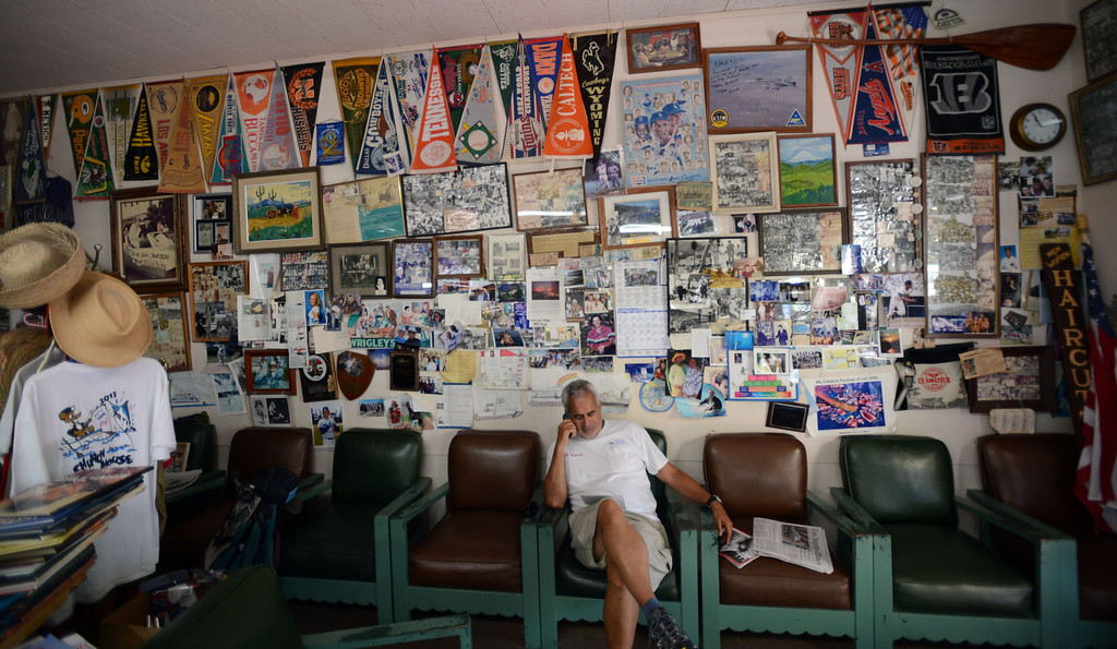 . Avalon, Calif., -- 09-04-13-  The wall\'s Lolo\'s Plaza Barber Shop in the city of Avalon ar filled with memories and memorabilia. This year Avalon turns 100. Lolo, now 83 was born on the Island and has many stories to tell about the Island and the was it is and the the way it used to be.    Stephen Carr/  Press-Telegram