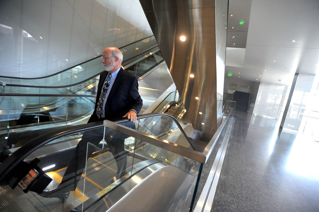 . A tour to compare the existing Long Beach Courthouse with the new Gov. George Deukmejian Courthouse in Long Beach showed how the new facility will help enhance operations at the courthouse. Judge James Otto uses the new convenient escalators. Photo by Sean Hiller/ Press Telegram/ LANG) 08-27-2013