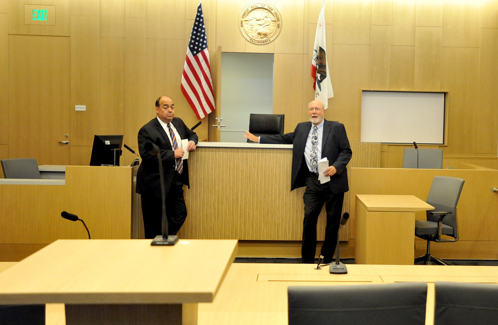 . A tour to compare the existing Long Beach Courthouse with the new Gov. George Deukmejian Courthouse in Long Beach showed how the new facility will help enhance operations at the courthouse. Judge Michael Vicencia,left, and Judge James Otto show a new courtroom. Photo by Sean Hiller/ Press Telegram/ LANG) 08-27-2013