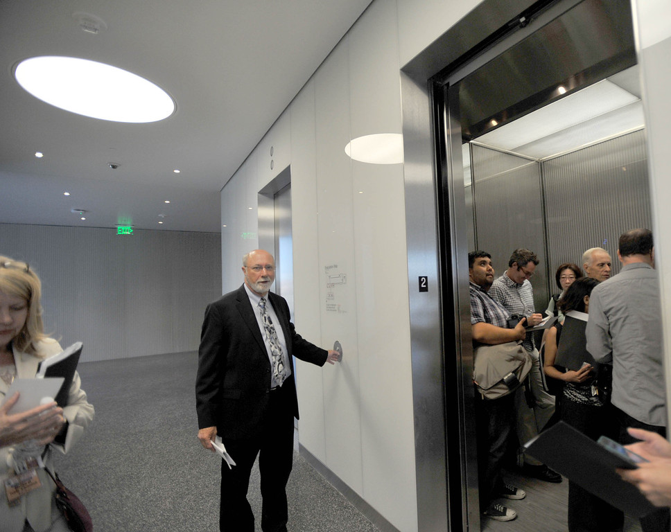 . A tour to compare the existing Long Beach Courthouse with the new Gov. George Deukmejian Courthouse in Long Beach. Supervising James Otto shows the new elevators. (Photo by Sean Hiller/ Press Telegram/ LANG) 08-27-2013