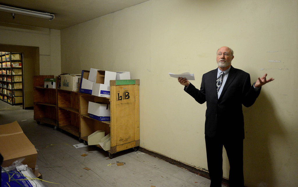 . A tour to compare the existing Long Beach Courthouse with the new Gov. George Deukmejian Courthouse in Long Beach. Supervising James Otto shows the file area in the old building. (Photo by Sean Hiller/ Press Telegram/ LANG) 08-27-2013