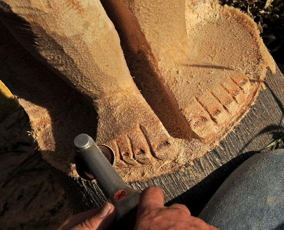 . Tiki Dave, carves the toes of a tiki he creates outside the Art House in Long Beach, CA. on Sunday, February 16, 2014. (Photo by Sean Hiller/ Daily Breeze).