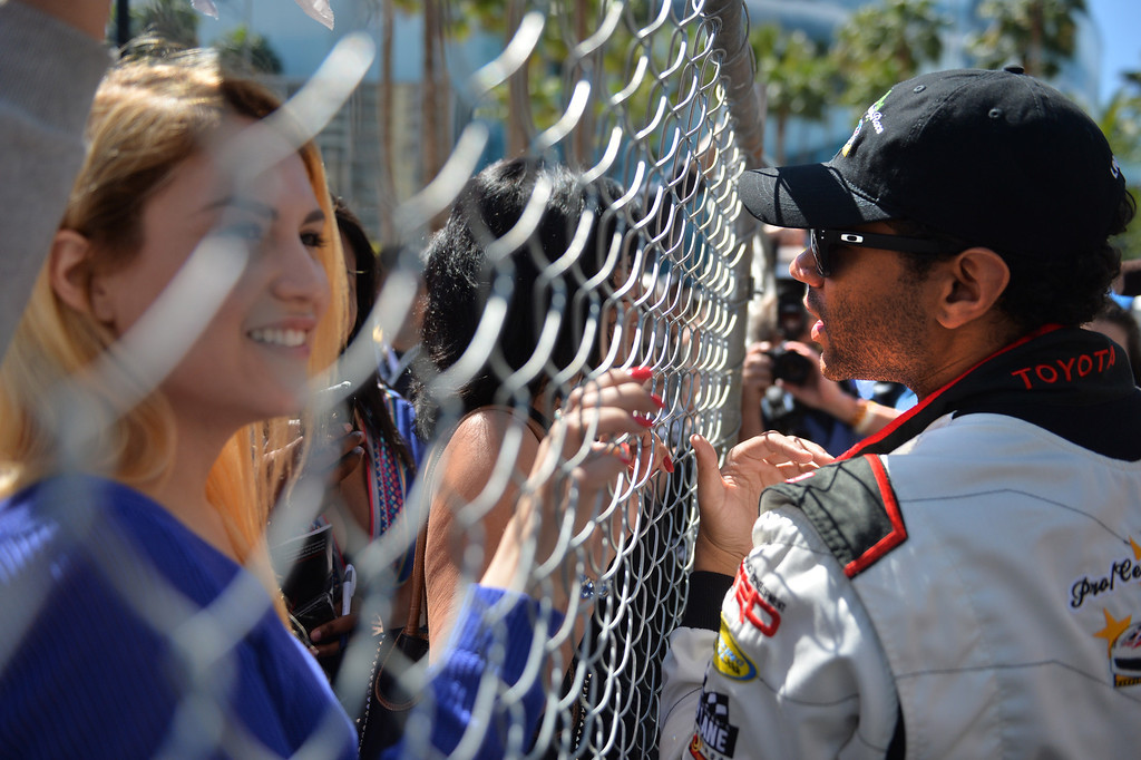 . Corbin Bleu chats with fans before a practice session at the Toyota Grand Prix of Long Beach Pro/Celeb Race. Long Beach April 11, 2014.  (Photo by Brittany Murray / Daily Breeze)