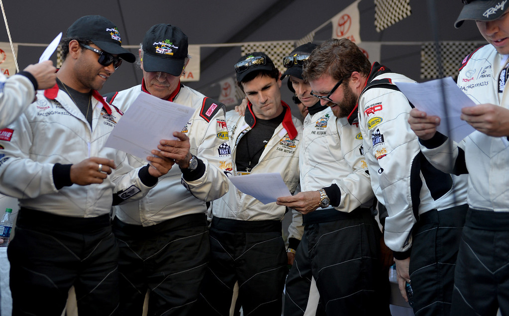 . Toyota Grand Prix of Long Beach Pro/Celeb Race drivers study their qualifying times. Long Beach April 11, 2014.(Photo by Brittany Murray / Daily Breeze)