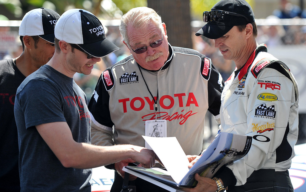 . Phil Keoghan, right,  before a practice session at the Toyota Grand Prix of Long Beach Pro/Celeb Race. Long Beach April 11, 2014.  (Photo by Brittany Murray / Daily Breeze)