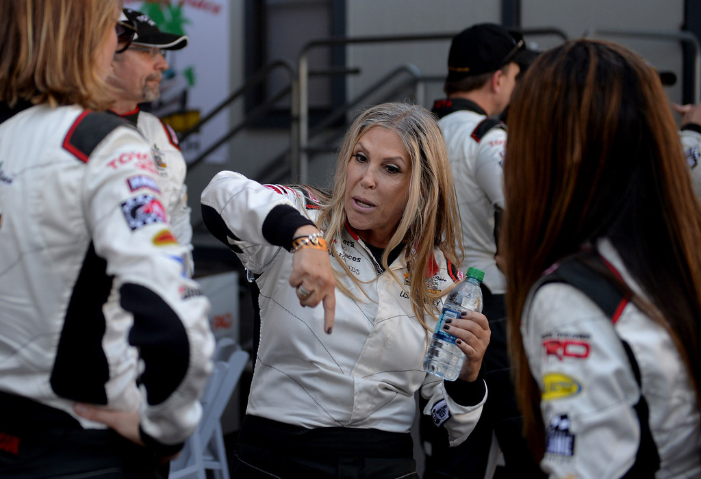 . Lisa Stanley talks about the crash that happened in front of her during the Friday qualifying session at the Toyota Grand Prix of Long Beach Pro/Celeb Race. Long Beach April 11, 2014. (Photo by Brittany Murray / Daily Breeze)