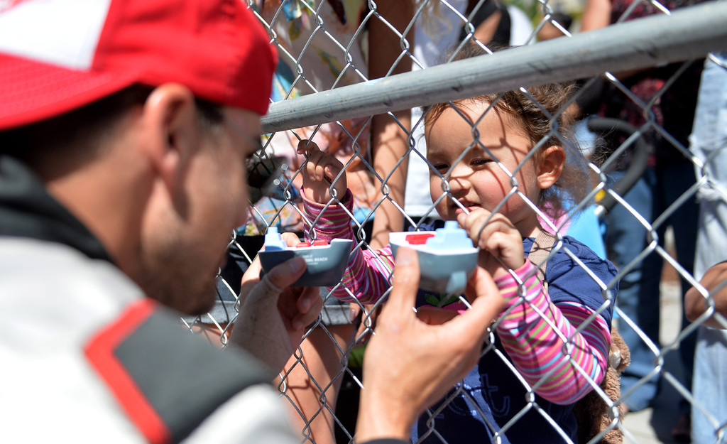 . Colin Egglesfield plays with young fan, Lindsey Quilter, 3,  before  the Friday qualifying session at the Toyota Grand Prix of Long Beach Pro/Celeb Race. Long Beach April 11, 2014. (Photo by Brittany Murray / Daily Breeze)