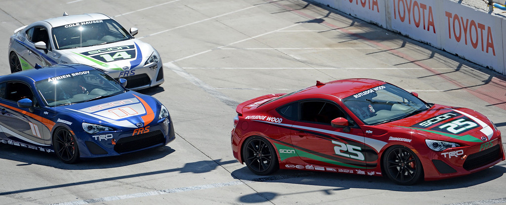 . Rutledge Wood in car 25 turns ahead of Adrien Broday in car 11 and Cole Hauser in car 14 during the celebrity race practice at the 40th Annual Toyota Grand Prix of Long Beach in Long Beach, CA. on Friday April 11, 2014. (Photo by Sean Hiller/ Daily Breeze).