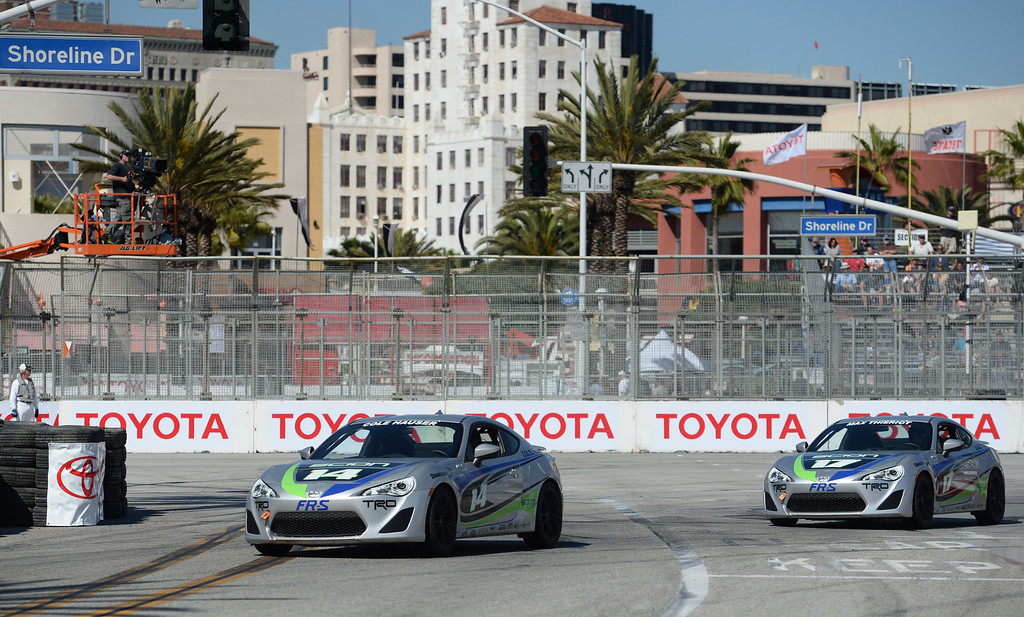 . Celebrities Cole Hauser, left, and Max Thieriot, right, compete in the celebrity qualifying at the 40th Annual Toyota Grand Prix of Long Beach in Long Beach, CA. on Friday April 11, 2014. (Photo by Sean Hiller/ Daily Breeze).