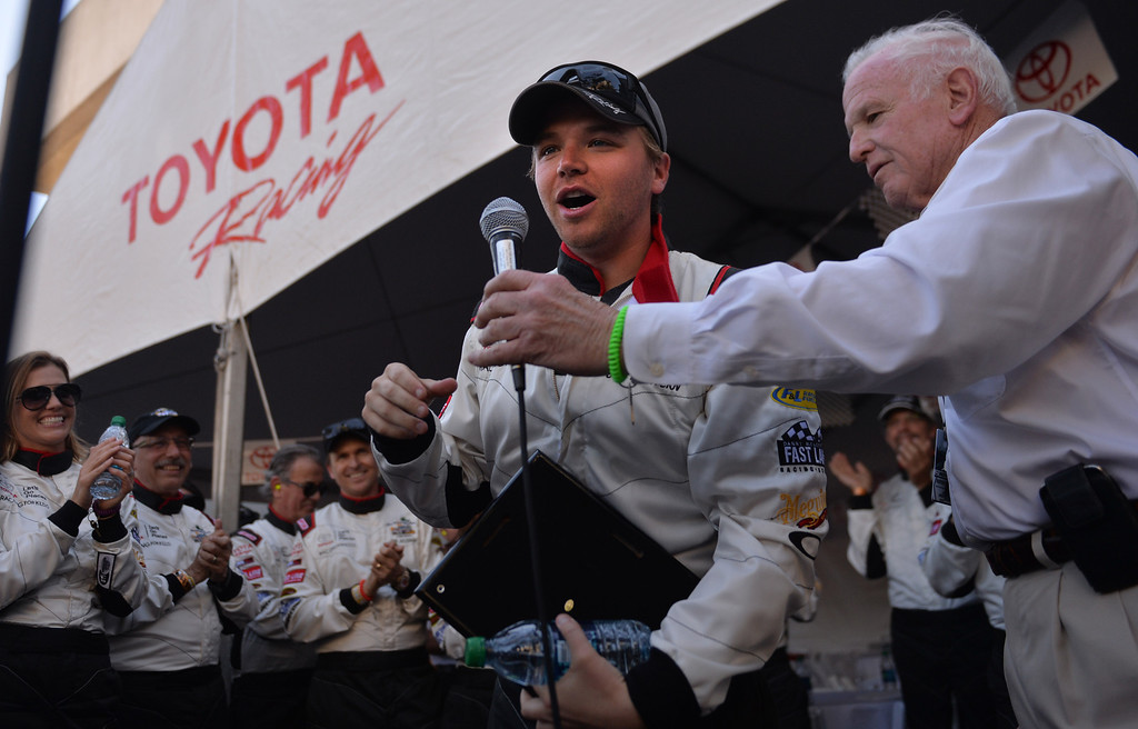 . Brett Davern accepts his plaque for being the top celebrity qualifier  on Friday at the Toyota Grand Prix of Long Beach Pro/Celeb Race. Long Beach April 11, 2014. (Photo by Brittany Murray / Daily Breeze)