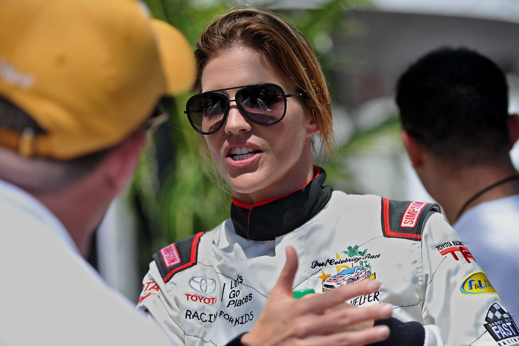. Tricia Helfer talks driving strategy with Brad Adams after a practice session at the Toyota Grand Prix of Long Beach Pro/Celeb Race. Long Beach April 11, 2014.  (Photo by Brittany Murray / Daily Breeze)