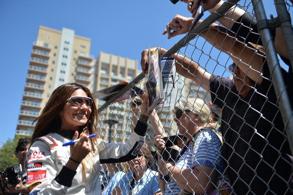 . Vanessa Marcil signs autographs for fans before a practice session at the Toyota Grand Prix of Long Beach Pro/Celeb Race. Long Beach April 11, 2014. (Photo by Brittany Murray / Daily Breeze)