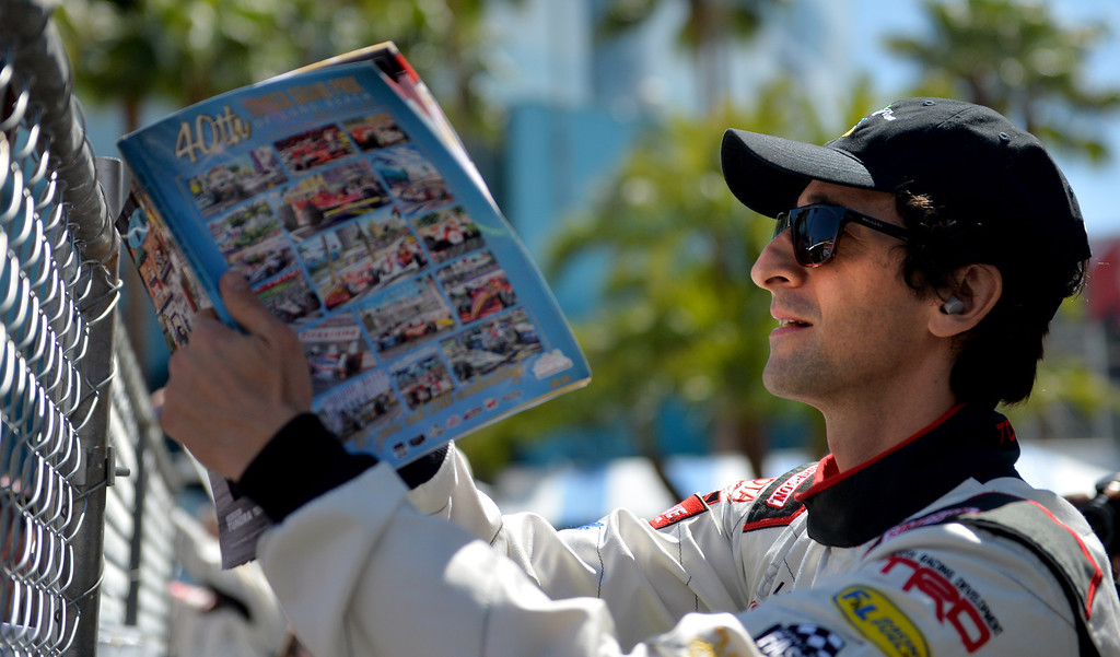 . Adrien Brody signs autographs before Friday qualifying session at the Toyota Grand Prix of Long Beach Pro/Celeb Race. Long Beach April 11, 2014.(Photo by Brittany Murray / Daily Breeze)