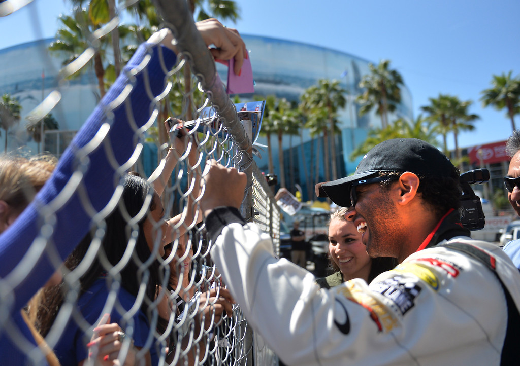 . Corbin Bleu signs autographs for fans before a practice session at the Toyota Grand Prix of Long Beach Pro/Celeb Race. Long Beach April 11, 2014. (Photo by Brittany Murray / Press Telegram)