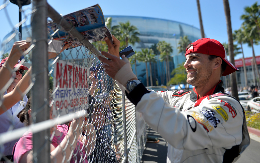 . Colin Egglesfield signs autographs for fans before a practice session at the Toyota Grand Prix of Long Beach Pro/Celeb Race. Long Beach April 11, 2014.  (Photo by Brittany Murray / Daily Breeze)