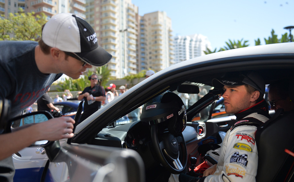 . Brett Davern gets in his car for a practice session at the Toyota Grand Prix of Long Beach Pro/Celeb Race. Long Beach April 11, 2014.  (Photo by Brittany Murray / Daily Breeze)