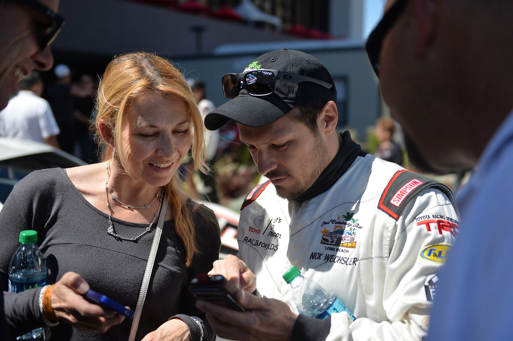 . Nick Wechsler chats with a fan before Friday qualifying session at the Toyota Grand Prix of Long Beach Pro/Celeb Race. Long Beach April 11, 2014. (Photo by Brittany Murray / Daily Breeze)