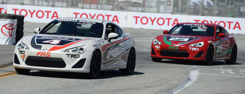 . Celebrity Vanessa Marcil in car 4  and Kyle Petty in car 23 practice for  the celebrity qualifying round at the 40th Annual Toyota Grand Prix of Long Beach in Long Beach, CA. on Friday April 11, 2014. (Photo by Sean Hiller/ Daily Breeze).