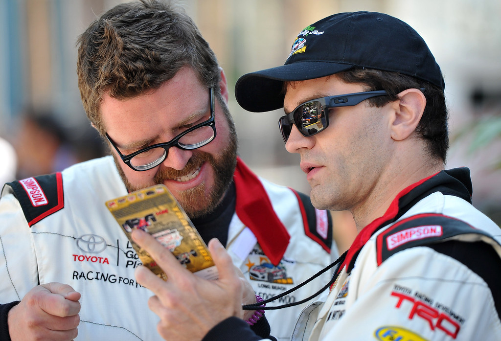 . L-R Rutledge Wood and Sam Witwer study up before the qualifying round of the Toyota Grand Prix of Long Beach Pro/Celeb Race. Long Beach April 11, 2014. (Photo by Brittany Murray / Daily Breeze)