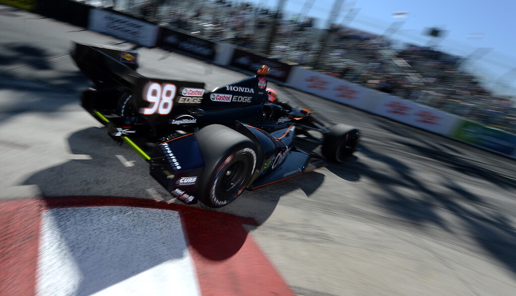 . Indycar driver Jack Hawksworth drives through the hairpin Friday morning April 11, 2014 in the first practice session at the 40th Toyota Grand Prix of Long Beach.  (Will Lester/Inland Valley Daily Bulletin)