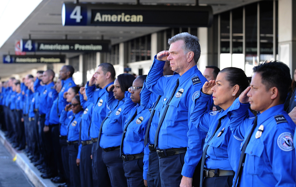 . A long line of TSA personnel salute the U.S. Honor Flag procession as it leaves Los Angeles International Airport.i In memory of TSA agent Gerardo Hernandez. It will be used at his upcoming funeral services. (Wed, Nov 6, 2013. Photo by Brad Graverson/The Daily Breeze/POOL)