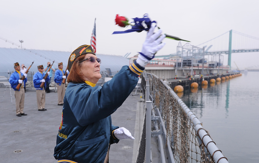 . Last four WWll survivors of USS Hoel which was sunk this date 1944. Memorial aboard the USS Iowa, San Pedro. VFW Post 2967 member Ora Jean Stevenson tosses a memorial rose into the water for those who did not survive.  (Fri. Oct. 25, 2013 Photo by Brad Graverson/The Daily Breeze)
