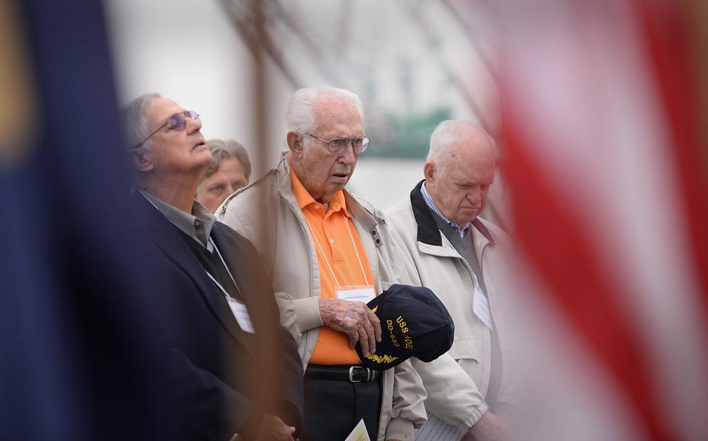 . Larry Morris, center, 89, was one of the survivors of USS Hoel which was sunk this date 1944. Memorial aboard the USS Iowa, San Pedro. His job was to load a 40mm cannon during battle.  (Fri. Oct. 25, 2013 Photo by Brad Graverson/The Daily Breeze)