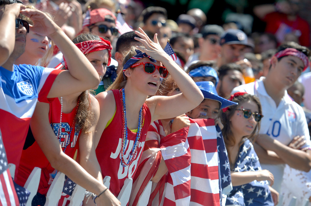 . Aimee Pierson of Lancaster, center, joins other fans as they react to United States losing to Belgium in the World Cup Soccer game in Long Beach CA. on Tuesday July 01, 2014. (Photo by Sean Hiller/ Daily Breeze).