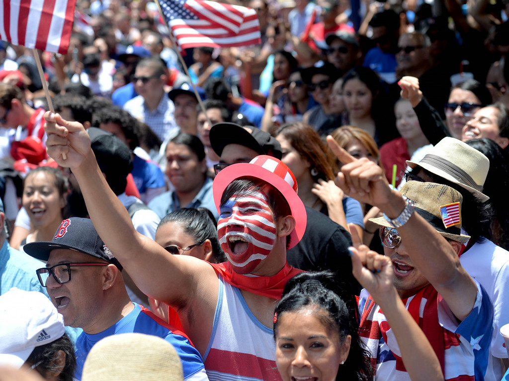 . Fans pack Pine Avenue to watch the United States play c in the World Cup Soccer game in Long Beach CA. on Tuesday July 01, 2014. (Photo by Sean Hiller/ Daily Breeze).