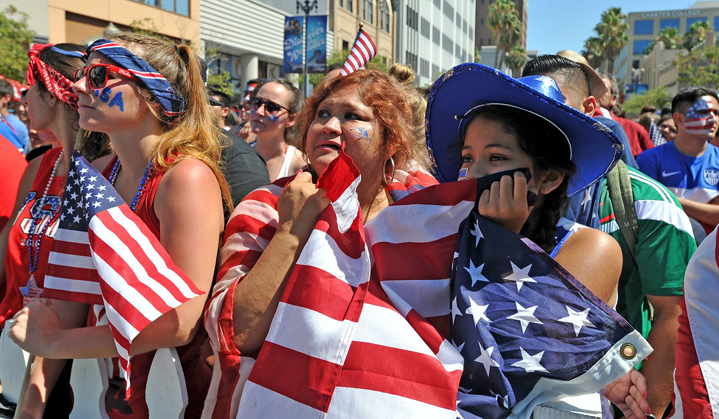 . Aimee Pierson of Lancaster, left, Dina Quintero, center and daughter Mia of Long Beach react as the clock runs out for United States against Belgium in the World Cup Soccer game in Long Beach CA. on Tuesday July 01, 2014. (Photo by Sean Hiller/ Daily Breeze).
