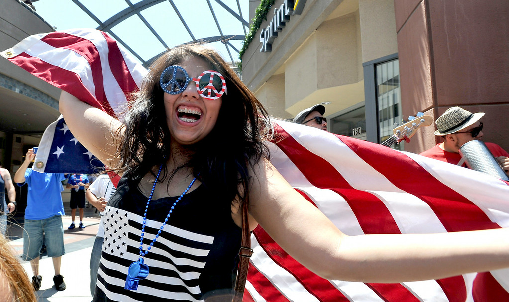 . Jennifer Zambrano of Riverside enjoys the party on Pine Avenue to watch the United States play Belgium in the World Cup Soccer game in Long Beach CA. on Tuesday July 01, 2014. (Photo by Sean Hiller/ Daily Breeze).