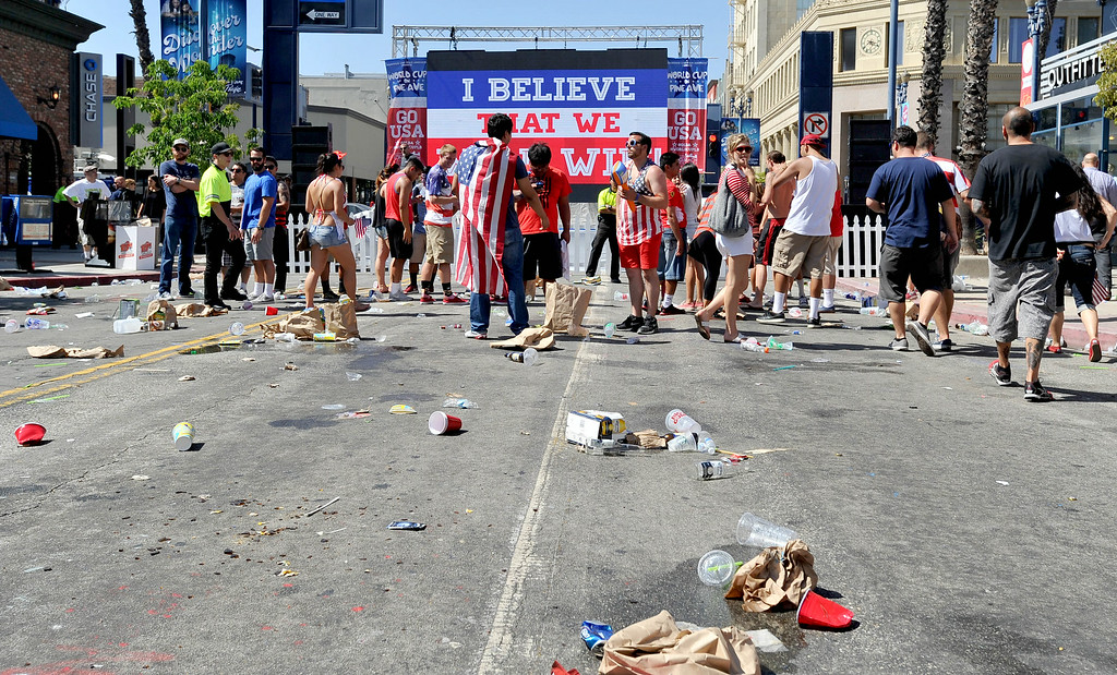 . Fans leave Pine Avenue after watching the United States lose to Belgium in the World Cup Soccer game in Long Beach CA. on Tuesday July 01, 2014. (Photo by Sean Hiller/ Daily Breeze).
