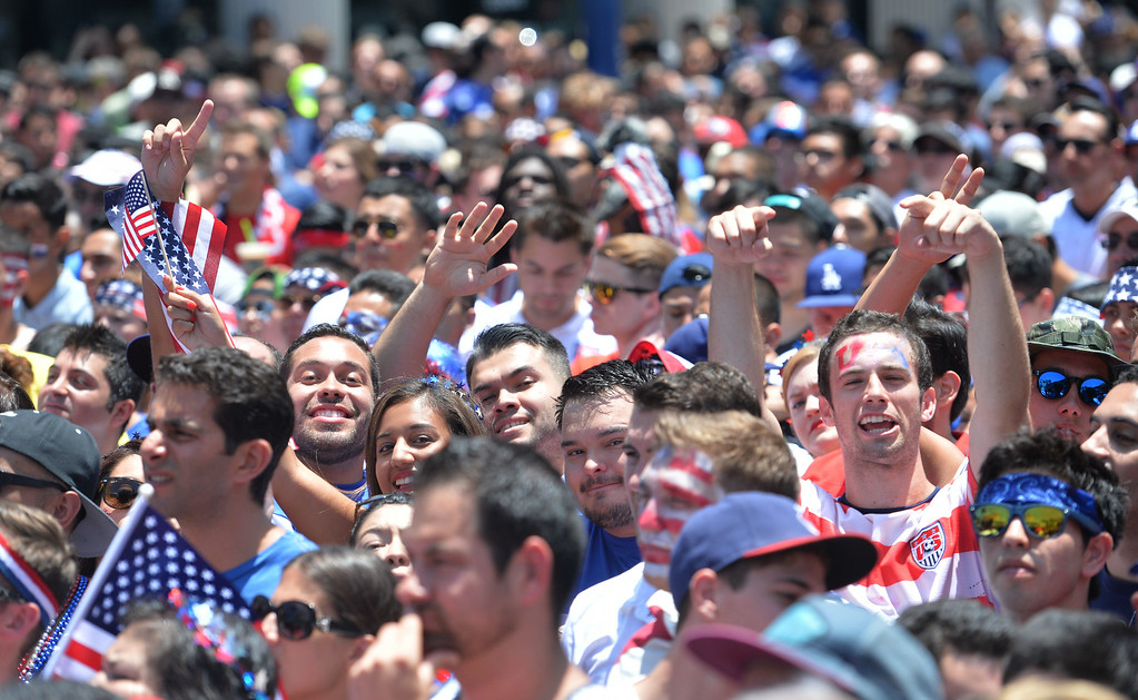 . Fans watch the jumbo screen on Pine Avenue to watch the United States play Belgium in the World Cup Soccer game in Long Beach CA. on Tuesday July 01, 2014. (Photo by Sean Hiller/ Daily Breeze).