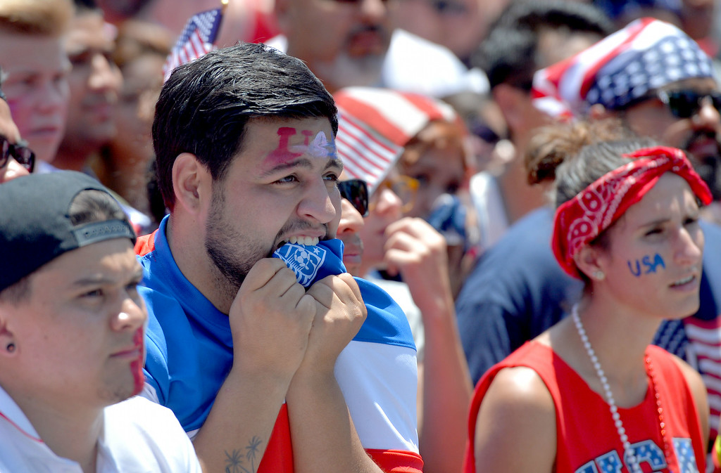 . Miguel Perez reacts to the game between the United States and Belgium in the World Cup Soccer game at a viewing party on Pine Avenue in Long Beach CA. on Tuesday July 01, 2014. (Photo by Sean Hiller/ Daily Breeze).