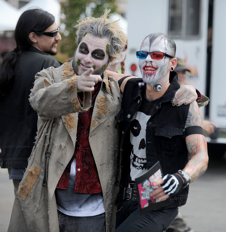 . Alex Haag, left, and Anthony Mejia join the undead to invad downtown during the annual Long Beach Zombie Walk in Long Beach, CA. on Saturday, October 26, 2013. (Photo by Sean Hiller/Press Telegram).
