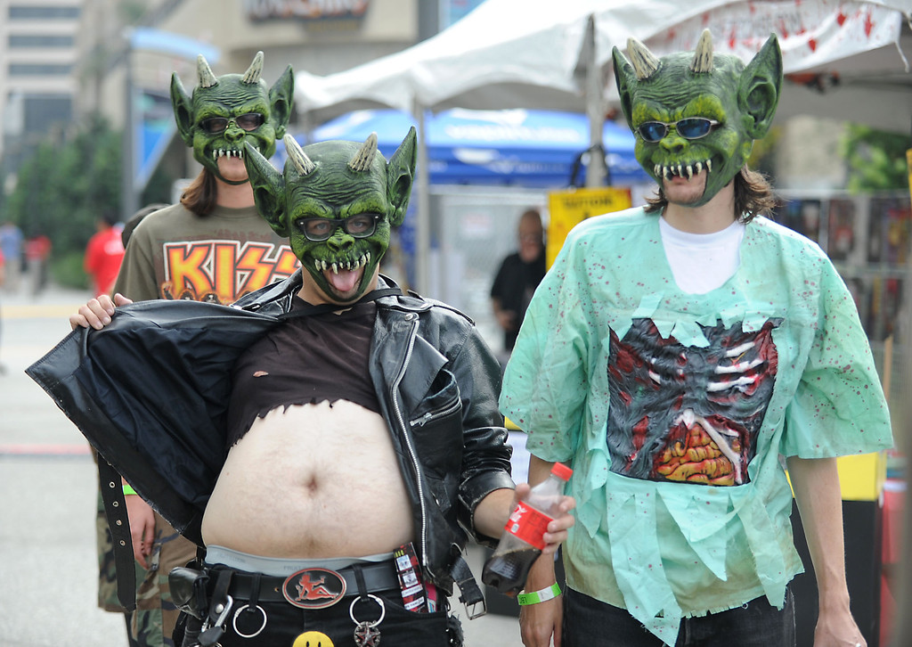 . Hugoroth shows his belly, as he arrives with friends Dr. Tickles, right, and Commander Ramsey, back, at the annual Long Beach Zombie Walk in Long Beach, CA. on Saturday, October 26, 2013. (Photo by Sean Hiller/Press Telegram).