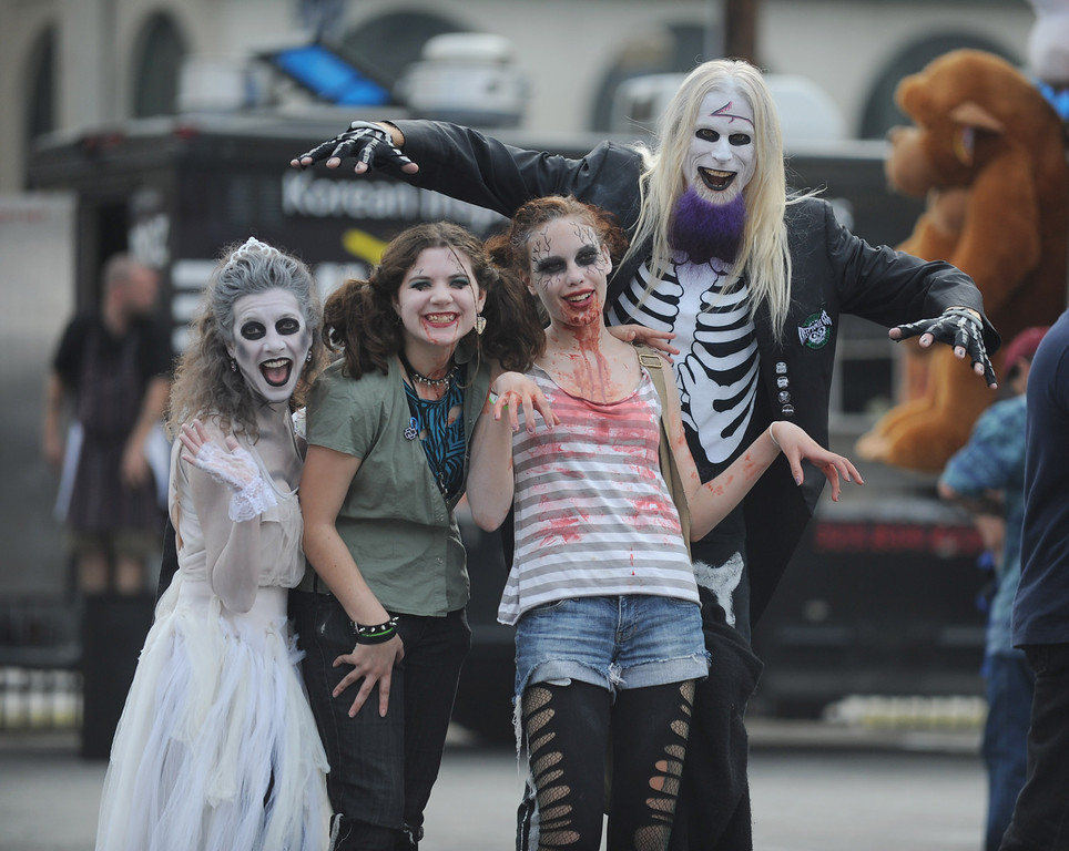 . Scarrie Carrie,left, Sam Gardina, Alia McDaniel, and Gruesome Gereg, right, of the band The Rhythm Coffin, hang out at the annual Long Beach Zombie Walk in Long Beach, CA. on Saturday, October 26, 2013. (Photo by Sean Hiller/Press Telegram).