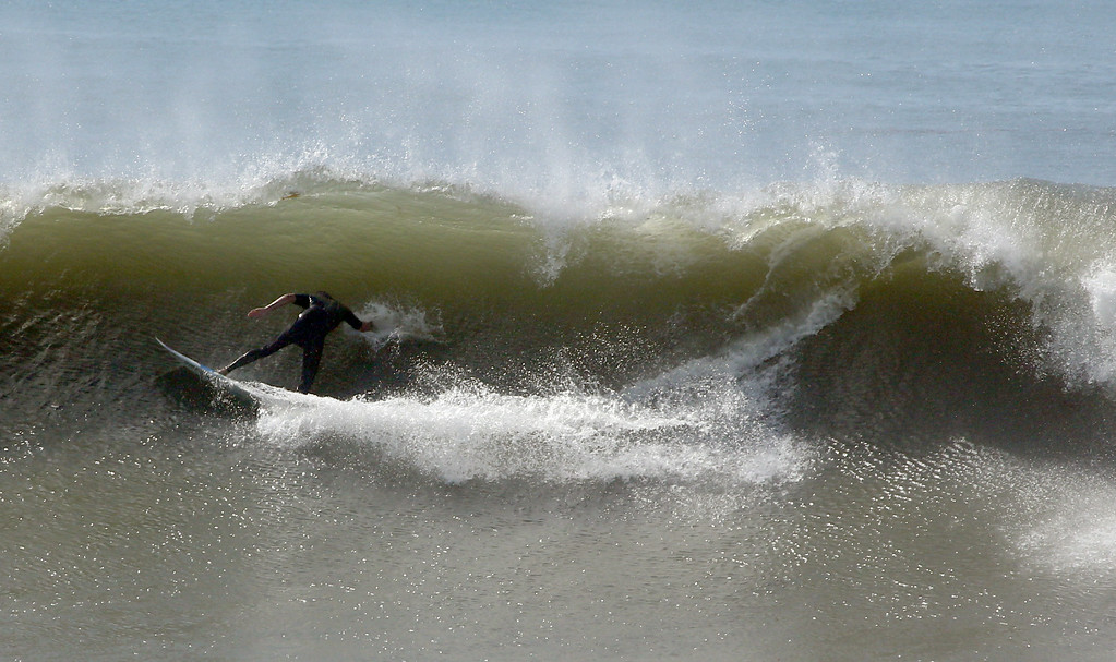 . Huge swells brought out surfers on Wednesday to Cabrillo Beach in San Pedro. The waves were generated by Hurricane Marie and and a high surf advisory has been issued through Friday. Chuck Bennett/Staff Photographer
