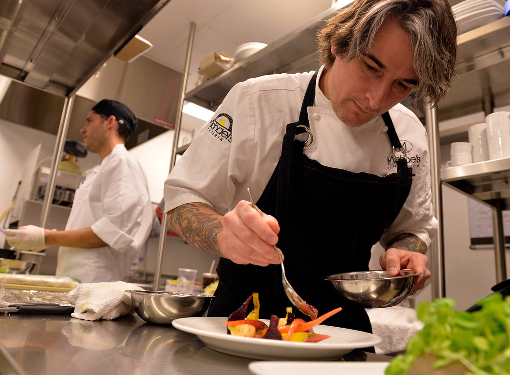 . David Coleman, Executive Chef, makes a Curried Winter Root Vegetable Salad at Chianina Steak in Long Beach, CA. December 18, 2013. The new restaurant will be open on December 27th. (Thomas R. Cordova/Press-Telegram/Daily Breeze)