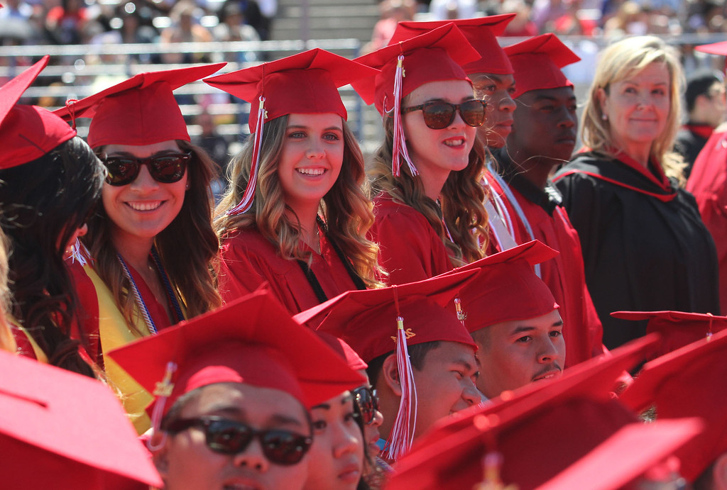 . Graduate candidates wait to be seated during Lakewood High School\'s commencement Thursday at Veterans Memorial Stadium in Long Beach, CA Thursday, June 12, 2014. (Photo by Mark Dustin for the Press-Telegram)