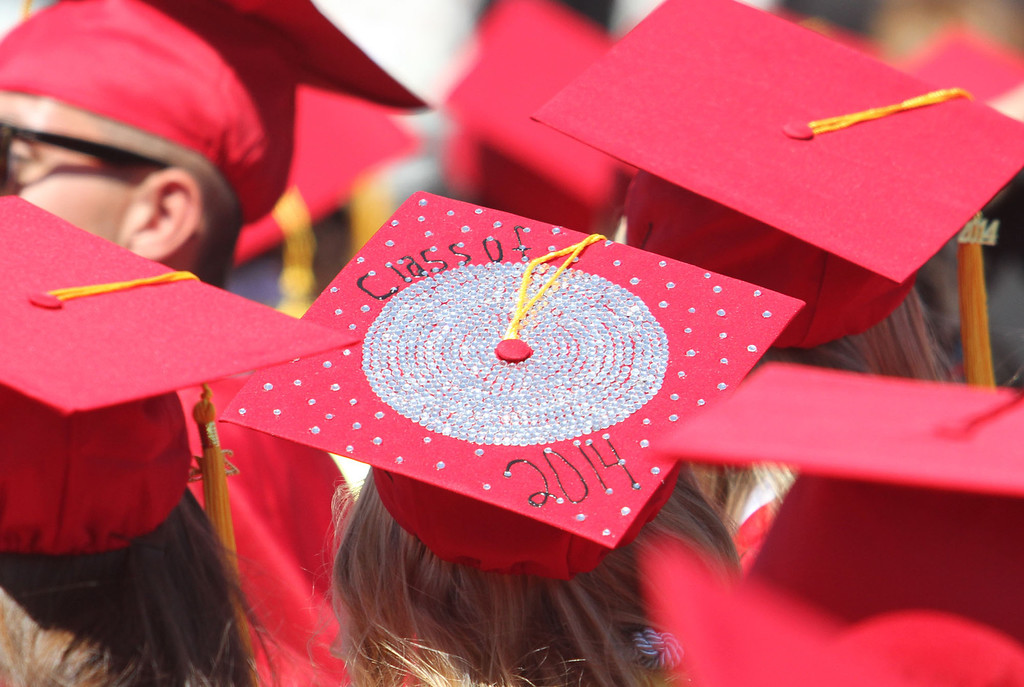 """. A graduate candidate decorated her cap with \""""Class of 2014\"""" decor for Lakewood High School\'s commencement Thursday at Veterans Memorial Stadium in Long Beach, CA Thursday, June 12, 2014. (Photo by Mark Dustin for the Press-Telegram)"""